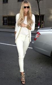 27. Elle Macpherson white jeans